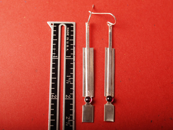 sterling handformed rectangular earrings with garnet cabochon shown with ruler for scale