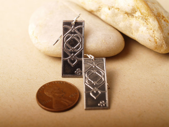 sterling silver rectangle earrings with celtic heart design french hooks hang long - shown next to a penny for scale