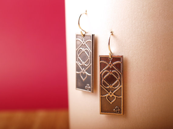 sterling etched rectangle earrings with celtic heart design hanging on white card