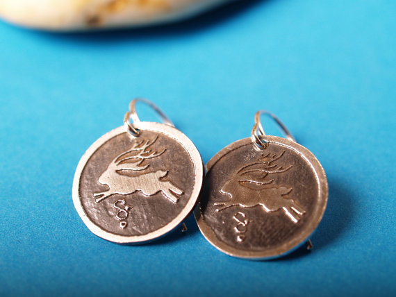 sterling round jackelope earrings on turquoise background