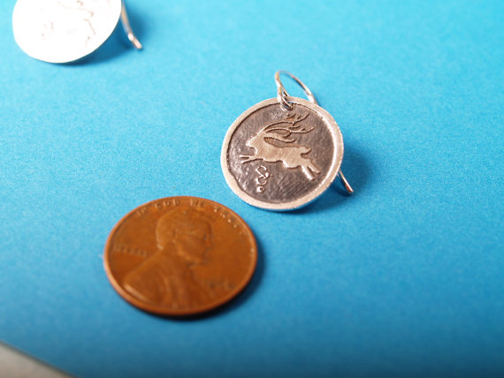round sterling jackelope earring with penny for scale