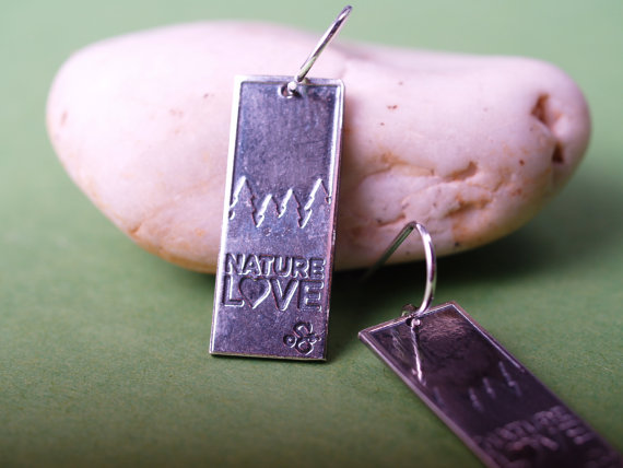 sterling rectangular etched earrings with french hooks - darker top treeline silhouette, Nature Love across the bottom - green background and pale stone closeup