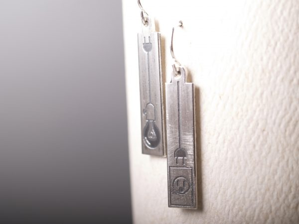 rectangle sterling etched earrings with lightbulbs hanging on a white earring card