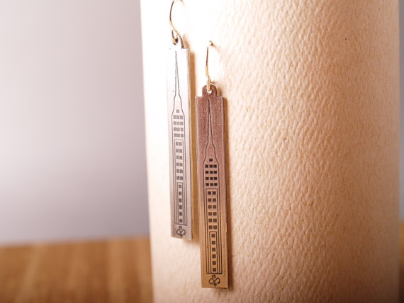 sterling etched long rectangle earrings with skyscraper design. French hook. Displayed on white card and hanging
