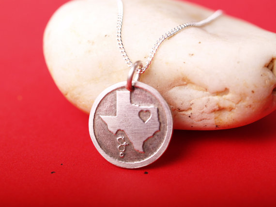 round etched sterling pendant featuring the state of Texas with a heart in northeast part of the state feature image