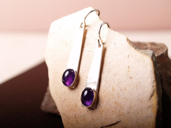 purple oval amethyst cabochons set in brushed sterling trapezoids with French hooks - shown on sandstone