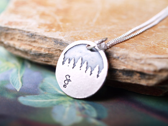 round sterling etched pendant showing a forest treeline feature image
