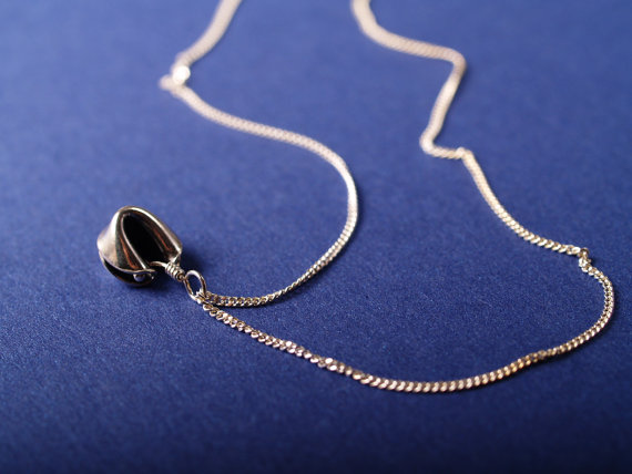sterling fortune cookie pendant on chain shown on blue field