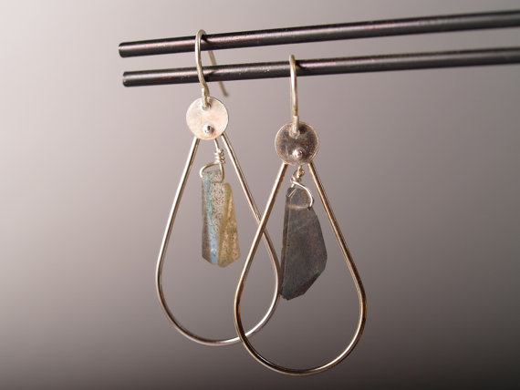sterling and labradorite hoop earrings on french hooks displayed on earring bar with grey background