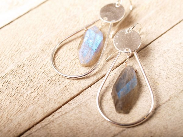 sterling and labradorite hoop earrings on french hooks close up on wood