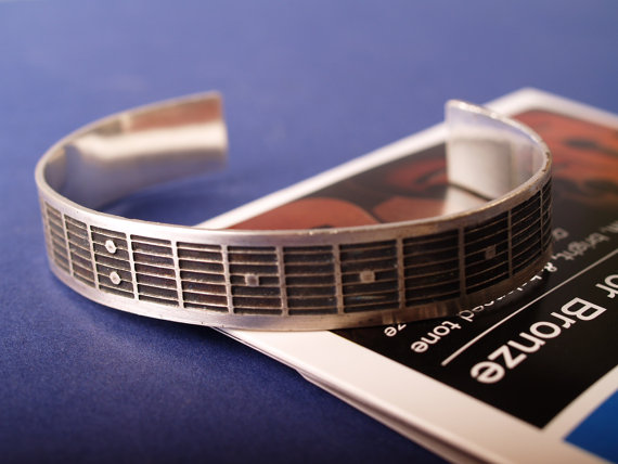 etched sterling cuff featuring fretboard pattern of a guitar feature image