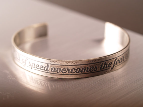 sterling etched cuff with the script Until the Thrill of Speed overcomes the Fear of Death with tire tread pattern on the ends image on shiny field