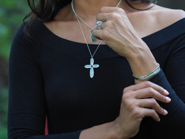 sterling hammered rounded cross with garnet photo on model