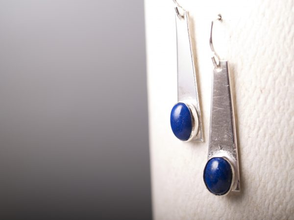 lapis cabochons set in brushed sterling cabochons with french hook earrings hanging on white and grey