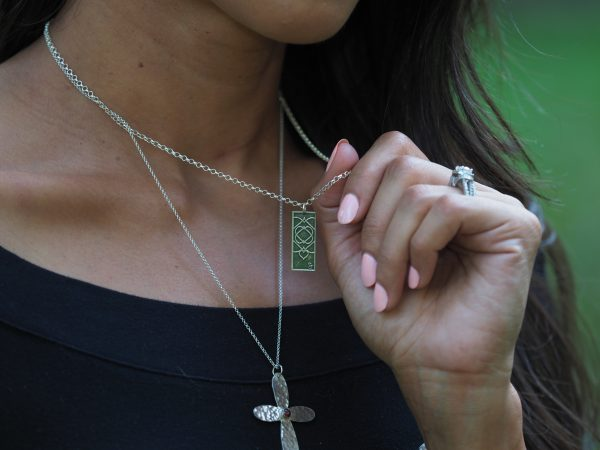 model wearing sterling etched five of hearts necklace