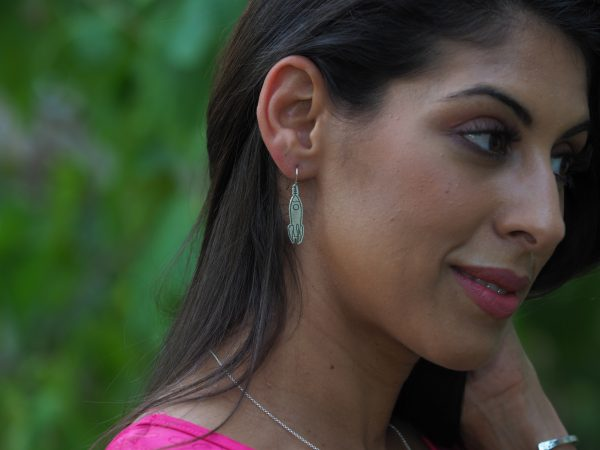 model in profile showing sterling dangle rocket earring