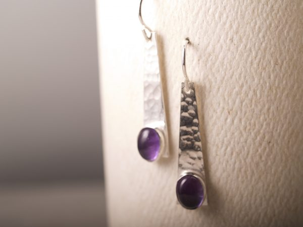 trapezoid shaped sterling earrings with amethyst oval cabohons and a hammered finish