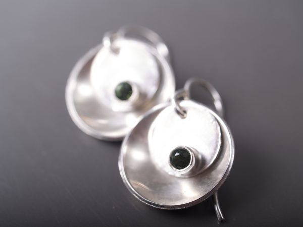 silver mirror and tab faceted emerald earrings on gunmetal