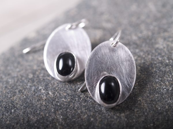 sterling and onyx earrings on grey granite