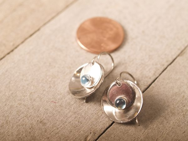 silver mirror and tab round blue topaz cabochon earrings - shot on barnwood with penny for scale