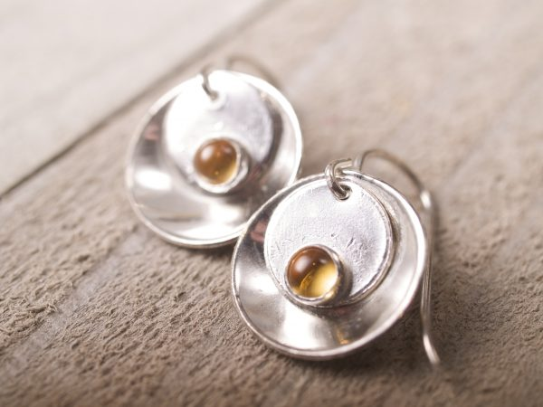silver mirror and tab round citrine cabochon earrings - photograph on barn wood