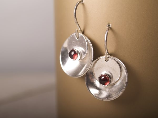 silver mirror and tab garnet cabochon earrings hanging on gold