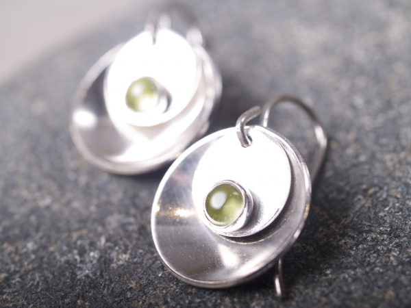 silver mirror and tab peridot cabochon earrings on blackstone