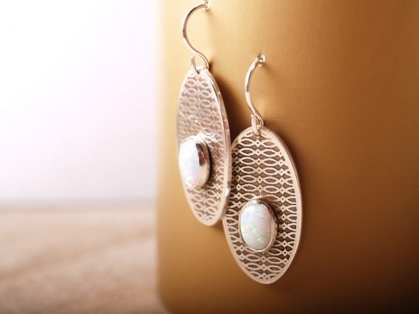 sterling dangle etched earrings with oval opal cabochons. French hooks hanging on bronze