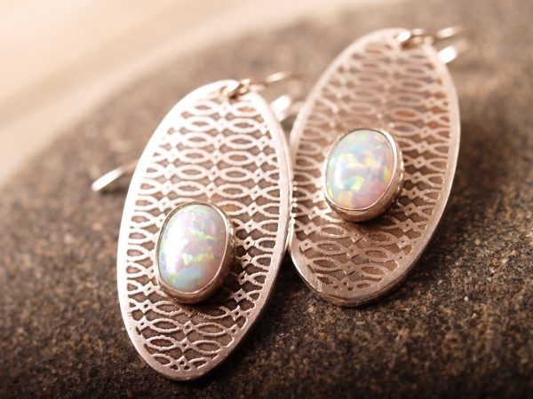 sterling dangle etched earrings with oval opal cabochons. French hooks on blackstone